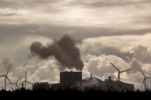 foto with smoke from industrie and windmills