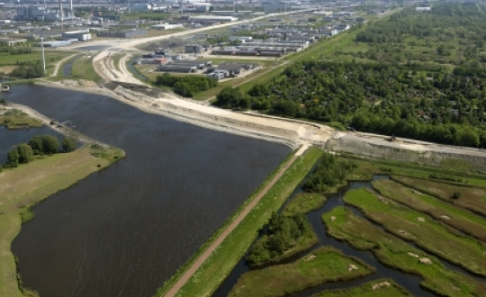 aerial photo of canal and dike, grassland, nature, city and industry